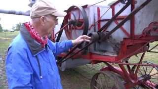 Wheat threshing machine powered by steam engine at Schumacher Farm