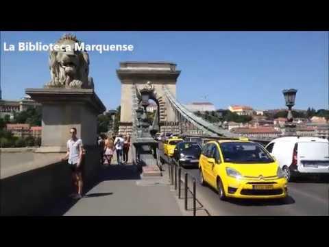 Walking through Chain Bridge in Budapest (Hungary)