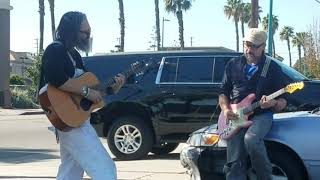 Two Guitarists Meet On The Street And....