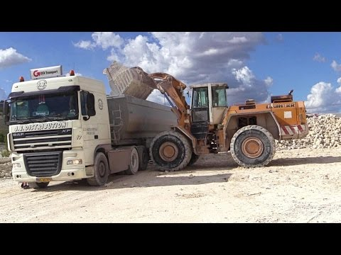 Liebherr L551 Wheelloader Loading Scania And Daf Trucks With Rocks