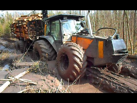 Valtra forestry tractor with big, fully loaded trailer