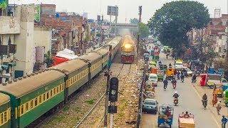 Trains Running In Busy Locality of Lahore City | Track Machine…