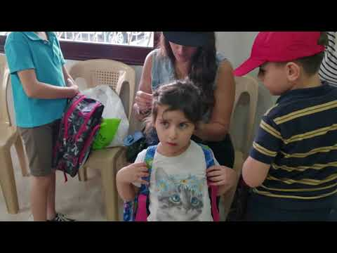 100 Aramean pupils from Northeast Syria receive school gifts in Tartus, West Syria
