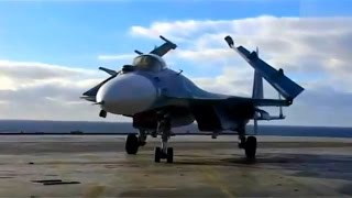 Su-33 'Flanker-D' work on aircraft carrier. Raw footage.
