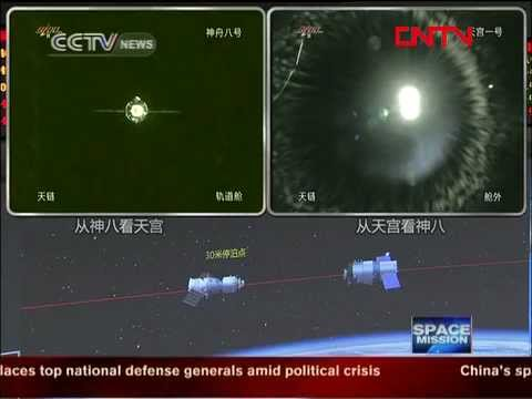 Chinese Shenzhou 8 spacecraft docks with Tiangong 1 space station