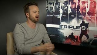 Triple 9: aaron paul talks u2, jay-z and his worst post-breaking bad roles