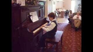 06-02-13 - Bubby (9 years) on piano - March of the Gladiators