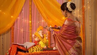 Indian woman worshiping Lord Ganesha with Puja thali - Bhagwan Ji Aarti
