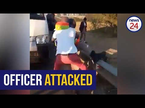 WATCH | JMPD officer wrestled to ground as bystanders watch
