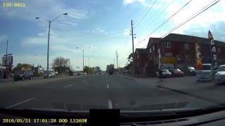 Four men run in front of Jeep Wrangler in Scarborough (Toronto)