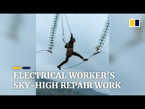 Chinese electrical worker's sky-high repair work