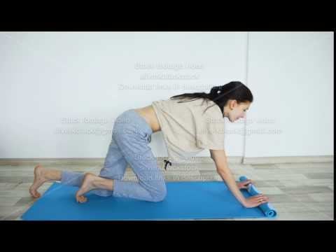 young-woman-doing-yoga-exercise---opening-her-yoga-mat
