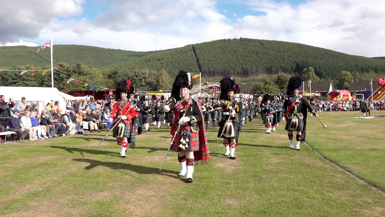 Download The massed pipes & drums afternoon parade at Ballater Highland Games in Deeside, Scotland, 2018
