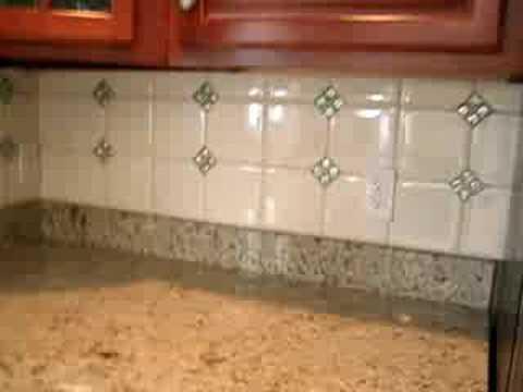 ceramic tile backsplash with glass mosaic tile inserts