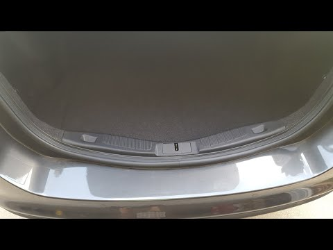 How to remove the trunk trim panel on a ford fusion