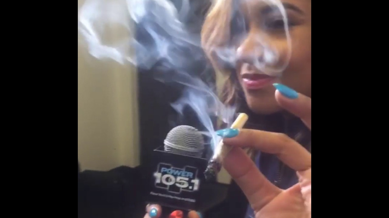 Angela Yee smoking a cigarette (or weed)