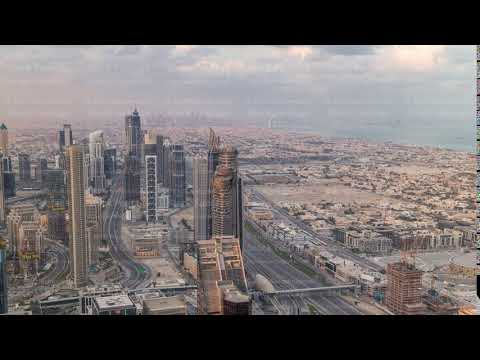 Dubai Downtown skyline futuristic cityscape with many skyscrapers and Burj Khalifa aerial timelapse.
