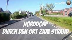 Mit dem Fahrrad durch Norddorf (Amrum) zum Strand