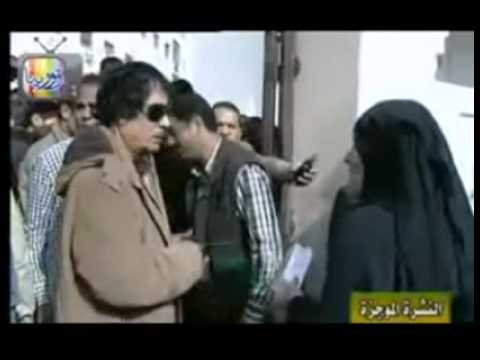 Gaddafi 2011 inspecting identities of some poor Libyans (with English subtitles)