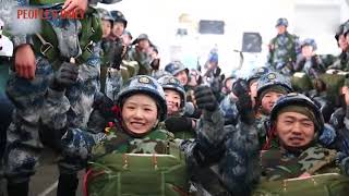 PLA Airborne female soldiers parachuting from thousands of meters in the air
