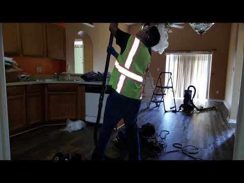 In processpost remodeling cleaning: vacuum popcorn ceiling and removing plastic from ceiling fans
