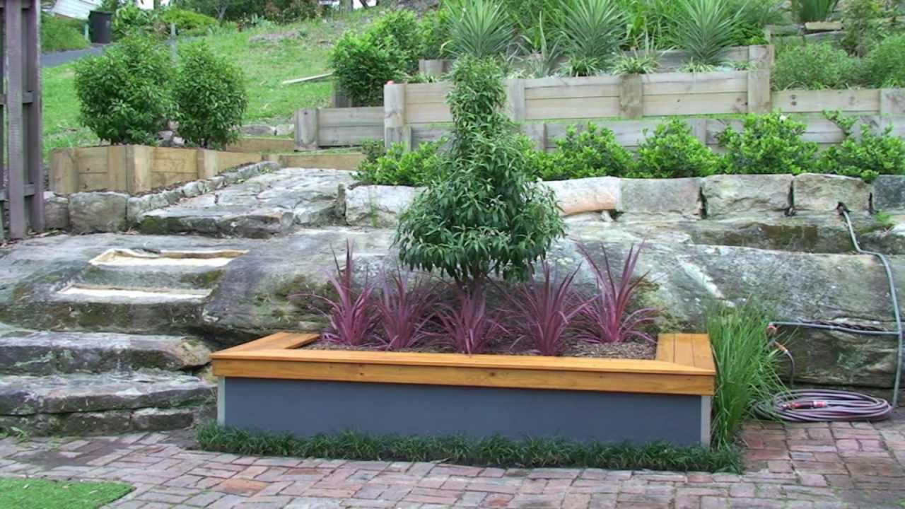 Build a garden bed with seat - YouTube