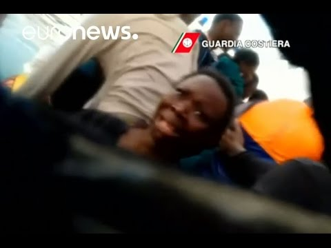 'You are safe.' Italian coastguard saves terrified migrants from sinking boat