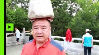 Камень на голове помог похудеть китайцу