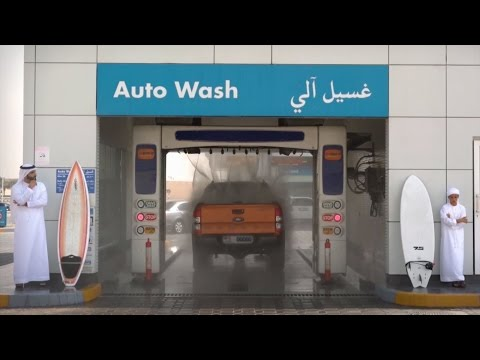 Mansour and Ahmed wash their vehicle at ADNOC Auto Wash