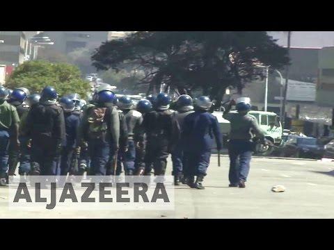 Zimbabwe police violently break up anti-Mugabe protests