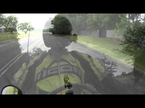 Motard wheelie practice in old drive-in theater parking lot