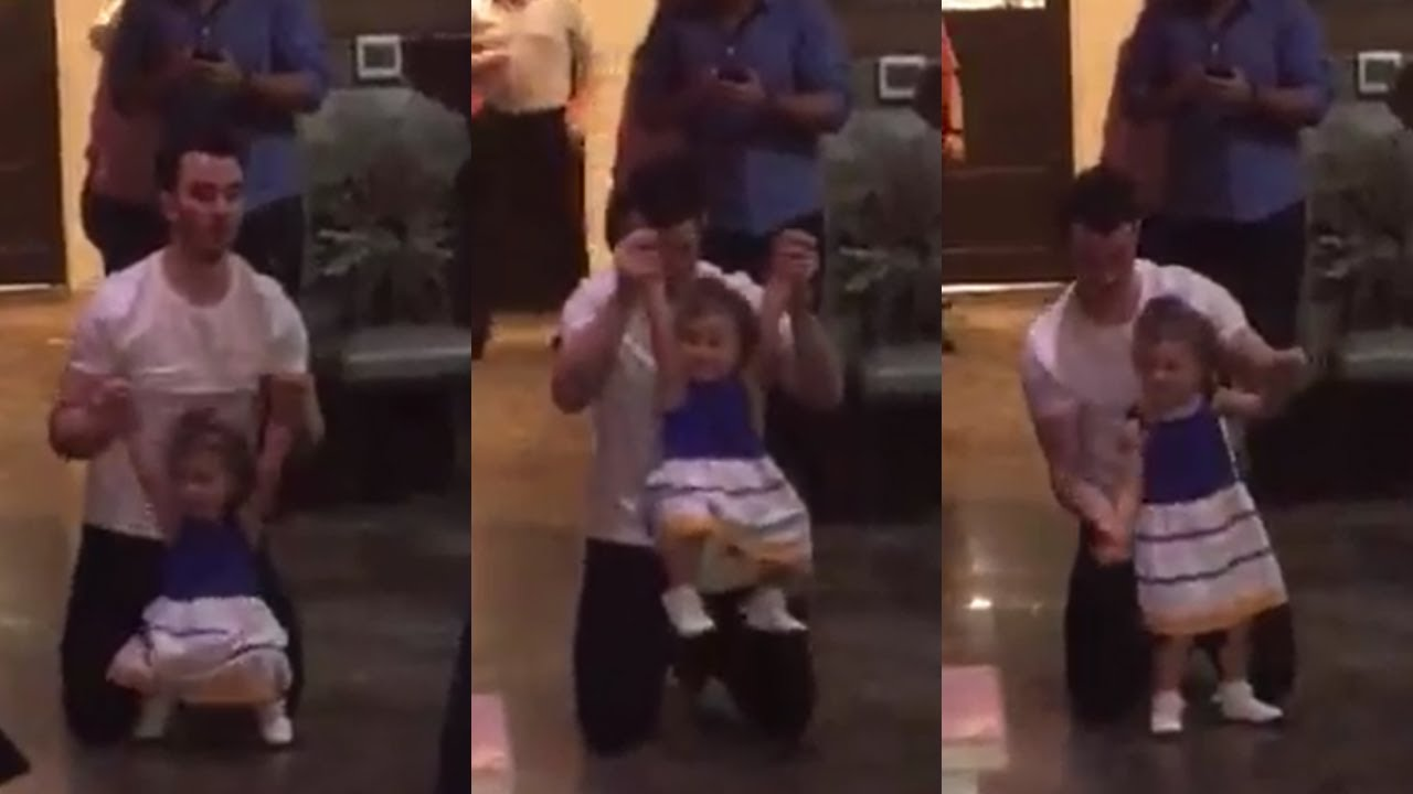 Kevin Jonas dancing with Alena at