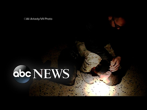 Photojournalist reveals graphic images of torture and execution by Iraqi troops