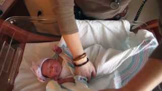 How to swaddle and calm a newborn baby