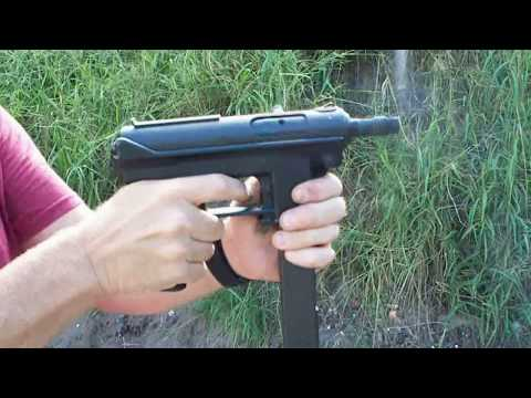 Tec 9 with a silencer