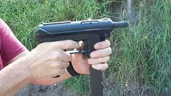 INTRATEC MOD. TEC-9 with a silencer. Yes, it's a TEC-9, just like it says on the gun.