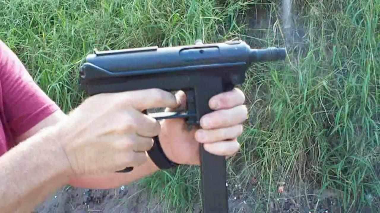 INTRATEC MOD  TEC-9 with a silencer  Yes, it's a TEC-9, just like it says  on the gun