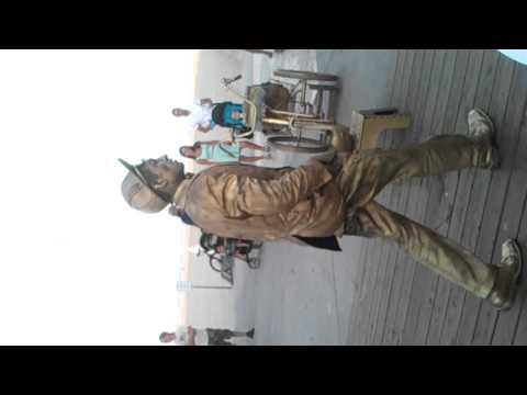 Gold man on ocean city md boardwalk