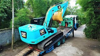 Gambar cover New Generation Excavator CAT 320GC Loaded And Transported By FAW Self Loader Truck