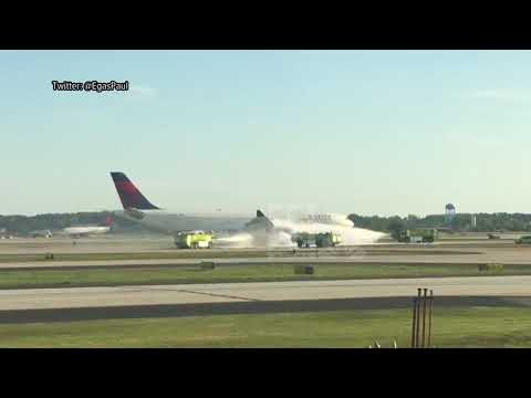 Video shows crews putting out fire aboard Delta jet at Atlanta airport