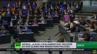 Merkel walks out of parliament as AfD leader slams her migration policies