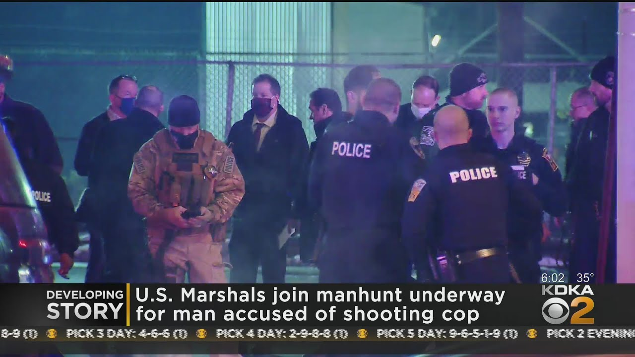 Manhunt Continues For Man Accused Of Shooting Police Officer