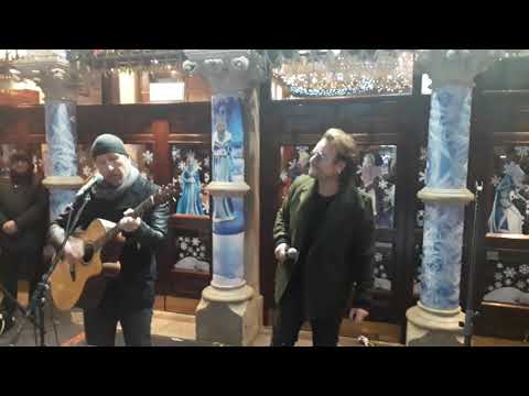 See U2's Bono and the Edge Busk in Dublin on Christmas Eve