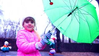 Ulya playing in the rain with umbrellas