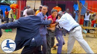 Chinese Workers in Uganda Assaulting Government Official