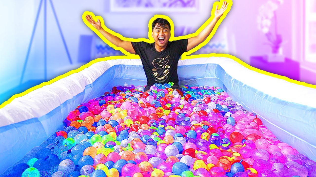 WATER BALLOONS IN A POOL YouTube - They gave this tiny dog some water balloons what happens next is hilarious