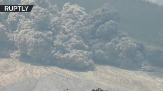 RAW  Mount Sinabung in Indonesia spews billows of ash 4km high after eruption