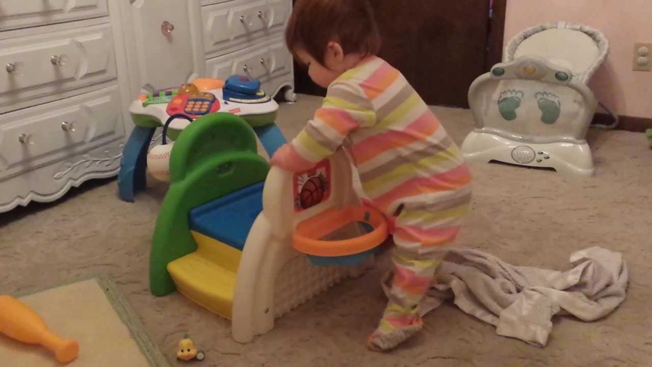 Evelyn plays basketball on toy from Grandpa John - YouTube