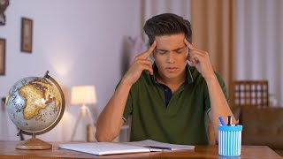 A handsome college-going student trying hard to concentrate on his studies - Study Pressure India