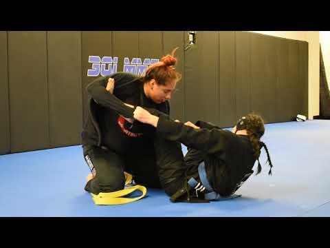 Jill Pierce and Rose Lobos sparring at 301 MMA